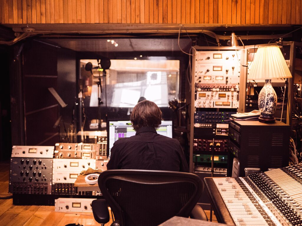 man sitting in a recording studio