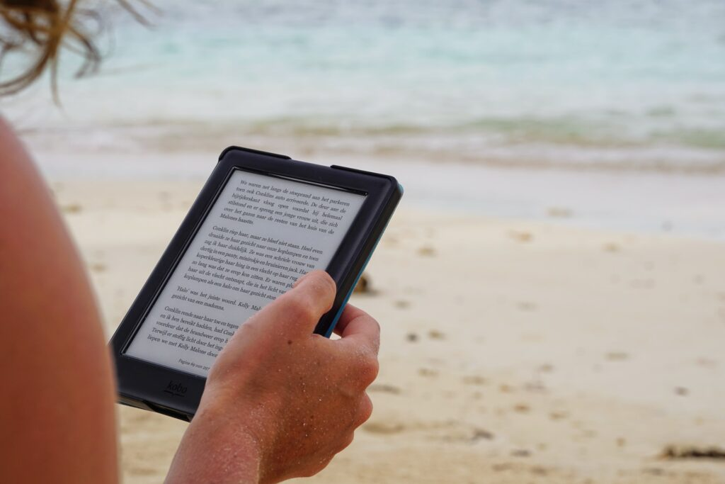 looking over the shoulder of someone reading on a Kindle device.